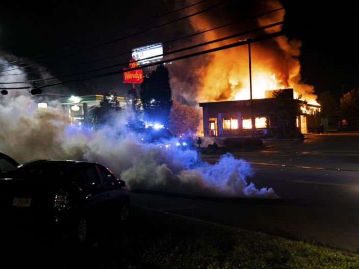 The Wendy's restaurant, where Rayshard Brooks was shot and killed by police in the parking lot, burns in Atlanta, June 13, 2020.  (Joshua Rashaad McFadden/The New York Times)